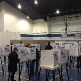 Rows of voting booths in a gym