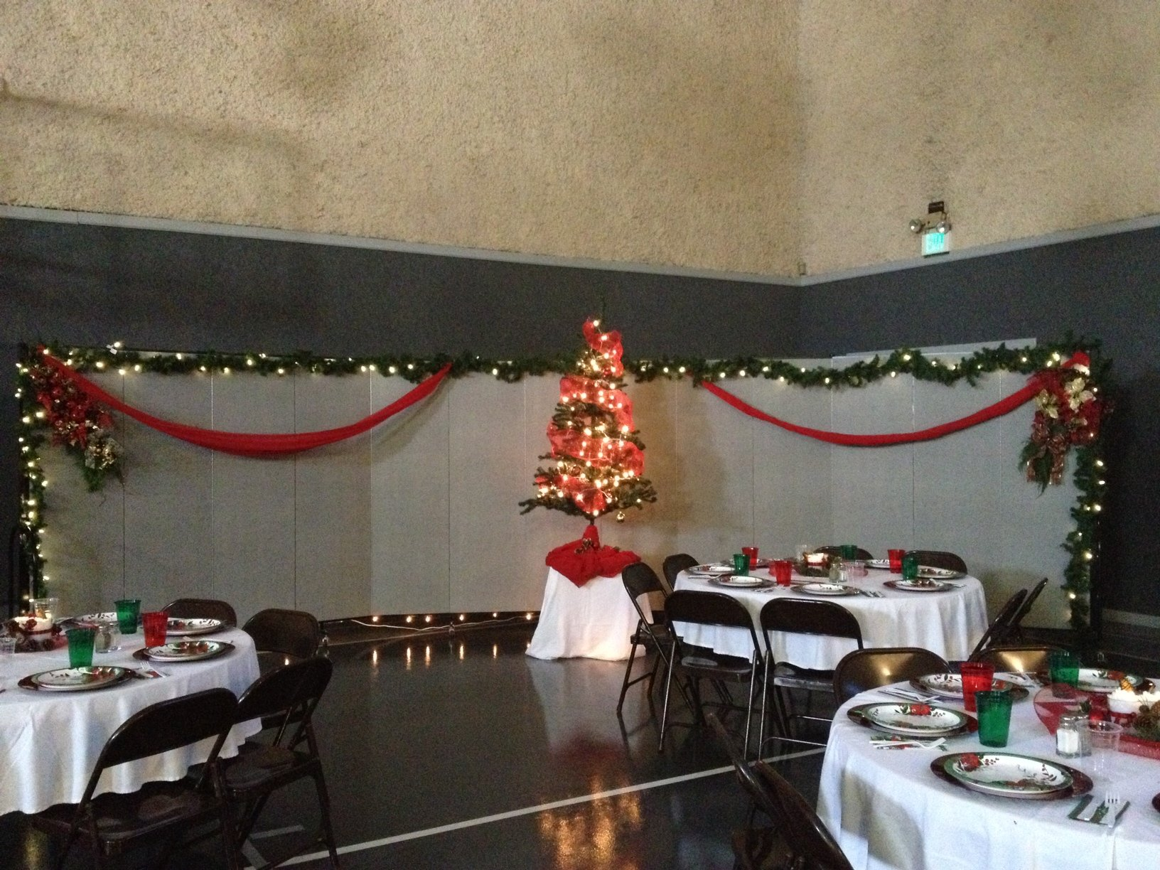 Decorated church gym for a women's Christmas banquet