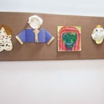 children artwork tacked to acoustical wall panel