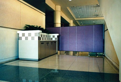 A portable partition wall behind a service counter in an arena