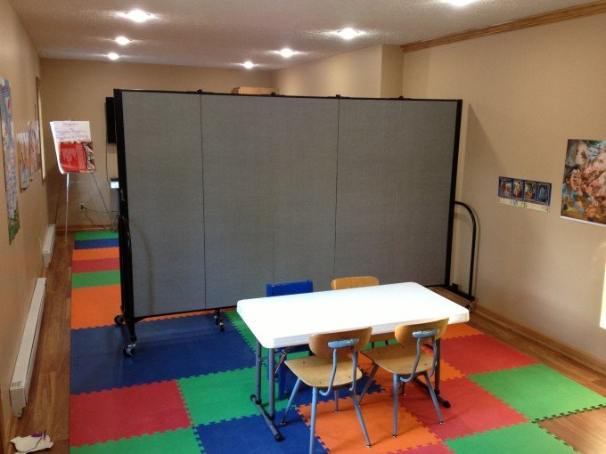 Portable classroom walls separate a room in two