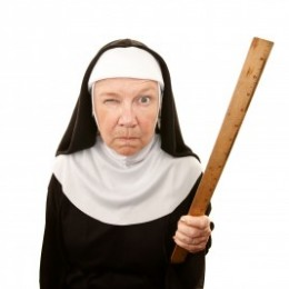 Stern Looking Nun with Ruler