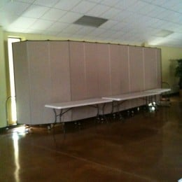 Divider wall protects unused items from view in a banquet hall.