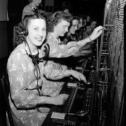 A row of switchboard operators at work.