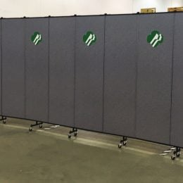 Grey room divider with Girl Scout logo on every-other panel