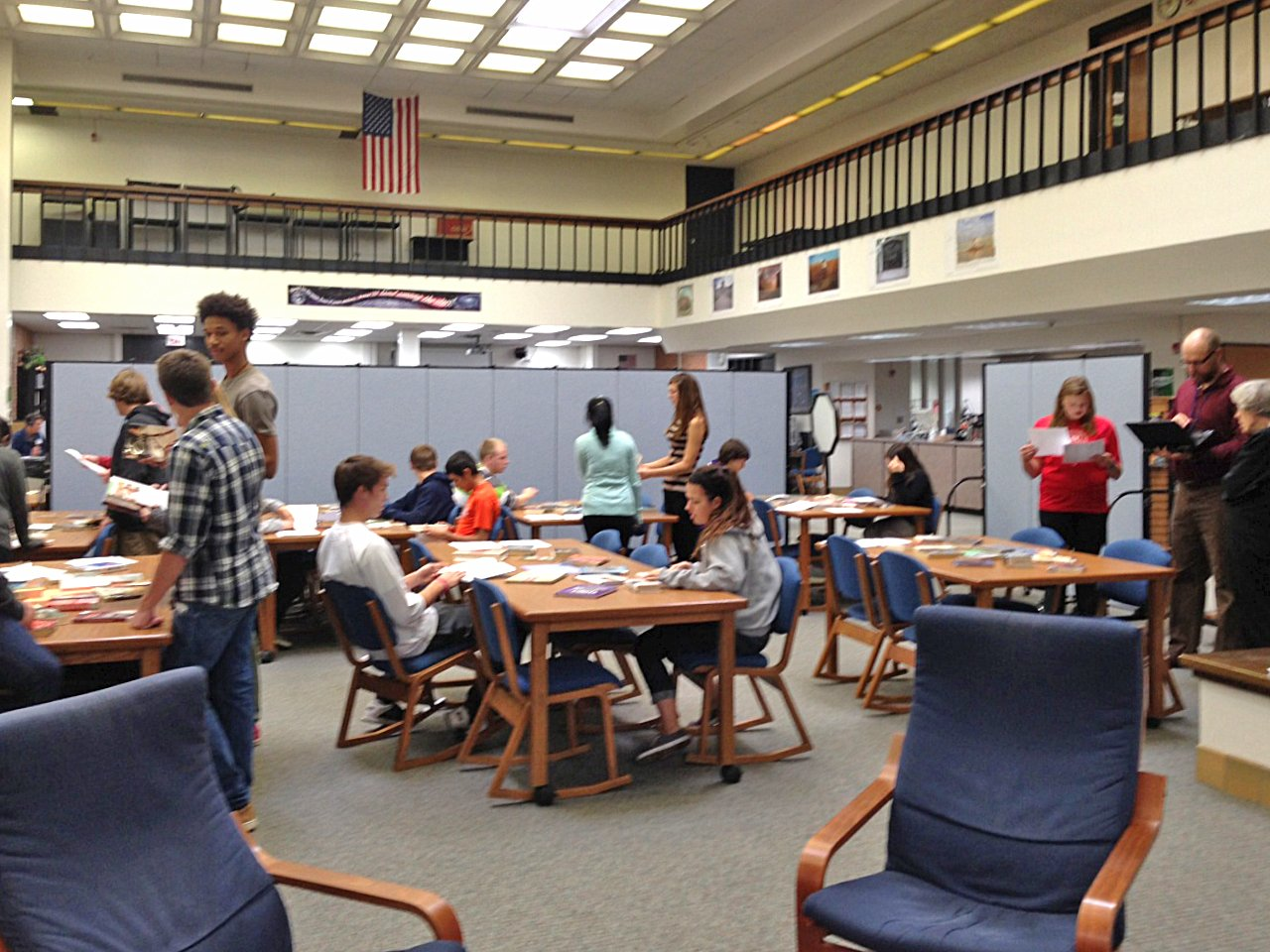 Students work on projects in a high school library classroom made with Screenflex Portable Room Dividers.