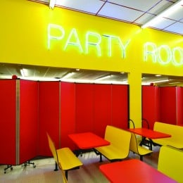 Party room space separated from game room with Screenflex Room Dividers at an indoor amusement park.
