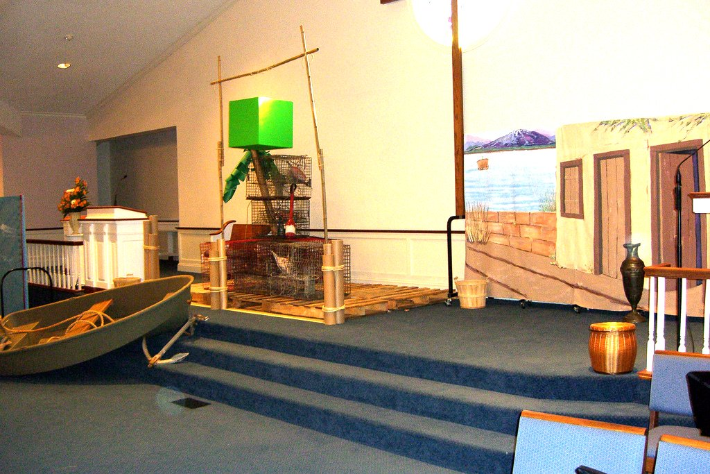 VBS drama stage created using an abandoned boat, a pier, and a fishing hut.