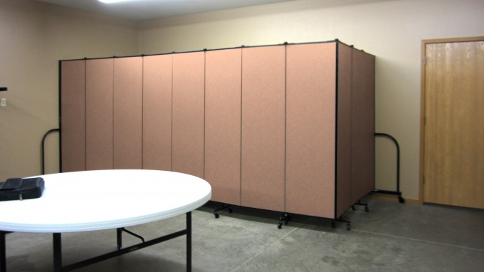 Folding partition walls hide tables and chairs