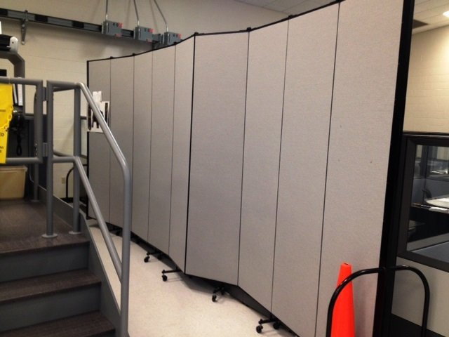 A privacy screen steals the show screenflex portable for Movable walls room partitions