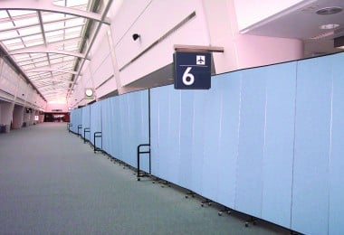 Industrial Room Dividers used to create a long continuous temporary wall at an airport terminal.