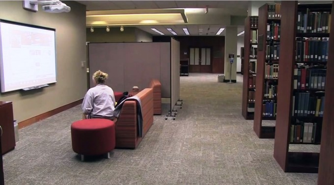 A quiet seating area amongst book stacks at Woodruff Health Sciences Center Library of Emory University.
