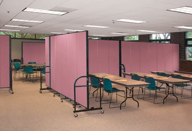 Mauve heavy duty room dividers create multiple meeting rooms within a larger room.