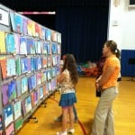 public viewing a school art exhibit