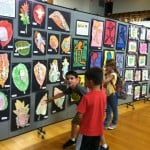 students viewing an art exhibit