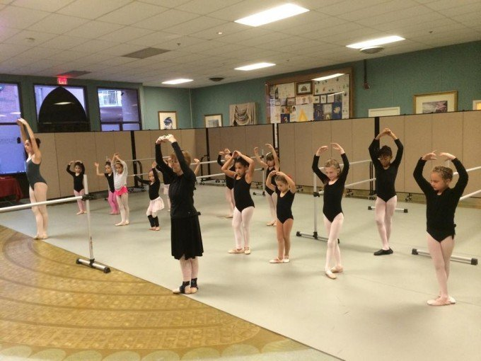 Wall divider creates privacy for a girls ballet class