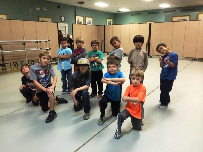 Wall dividers improve privacy during a boys hip hop class