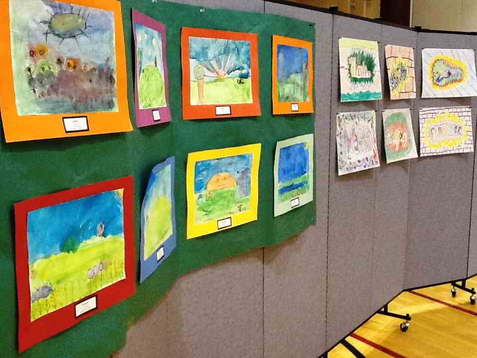 Student artwork displayed on Screenflex room divider