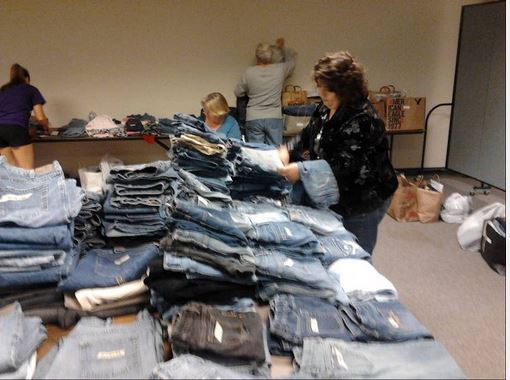 St. Vincent de Paul Clean Jeans Drive Volunteers sort jeans