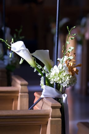 Pew flowers at a church wedding