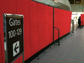 Red airport dividers secure a gate terminal
