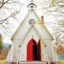 Country church with open red doors