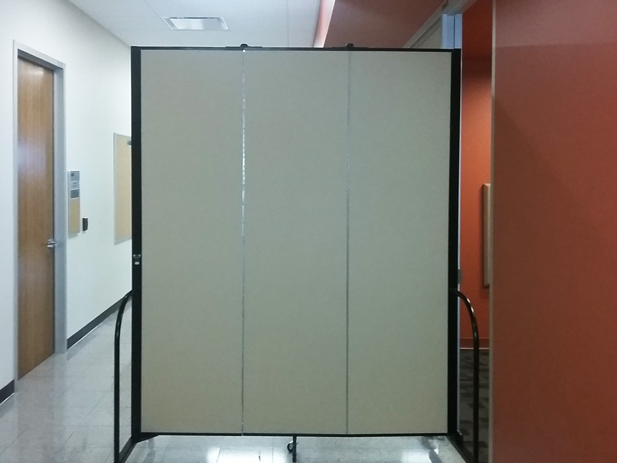 Sound absorbing panel in a hallway