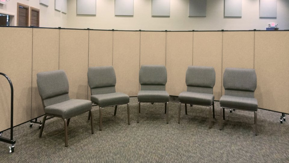 A room divider creates a small group meeting space in the sanctuary