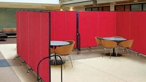 A set of all-purpose room dividers are connected to create a conference center room in a hotel lobby
