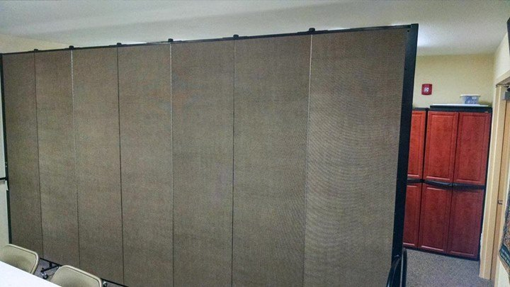 Customer provided image of room divider in a classroom