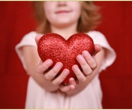 Girl holding heart