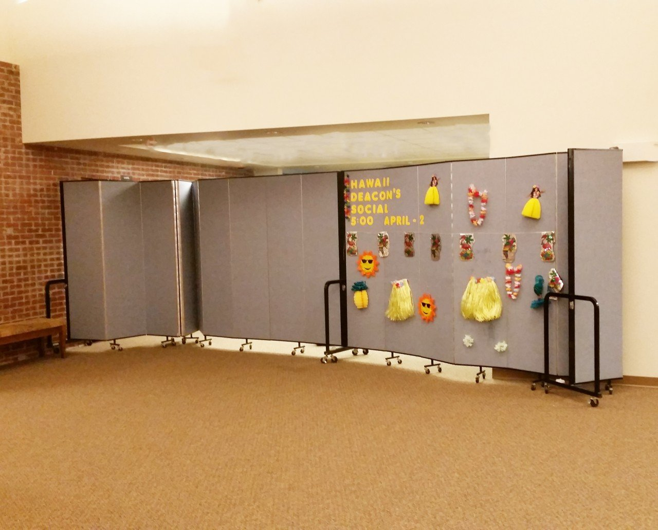 A portable partition is used to create more classrooms in a church hallway