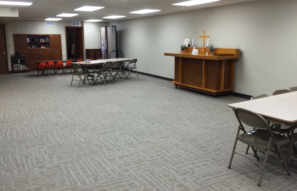 Room dividers are stored to the side waiting to be used in a church multipurpose room