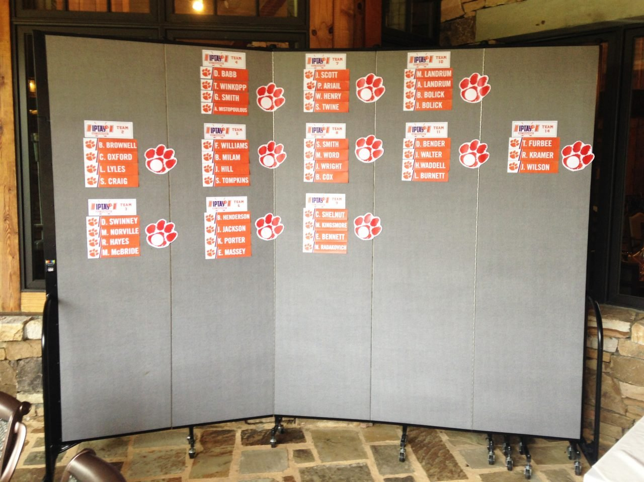 Moveable walls are used to display golf score cards for a tournament