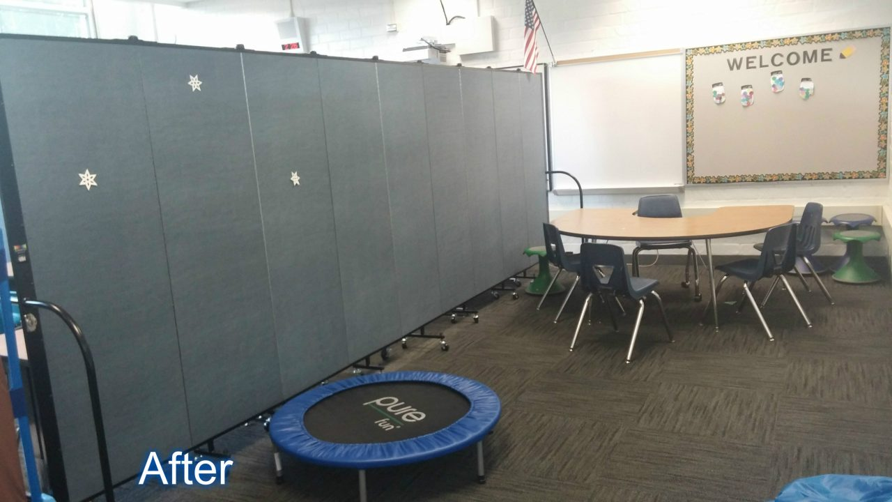 A room divider splits a therapy classroom in two