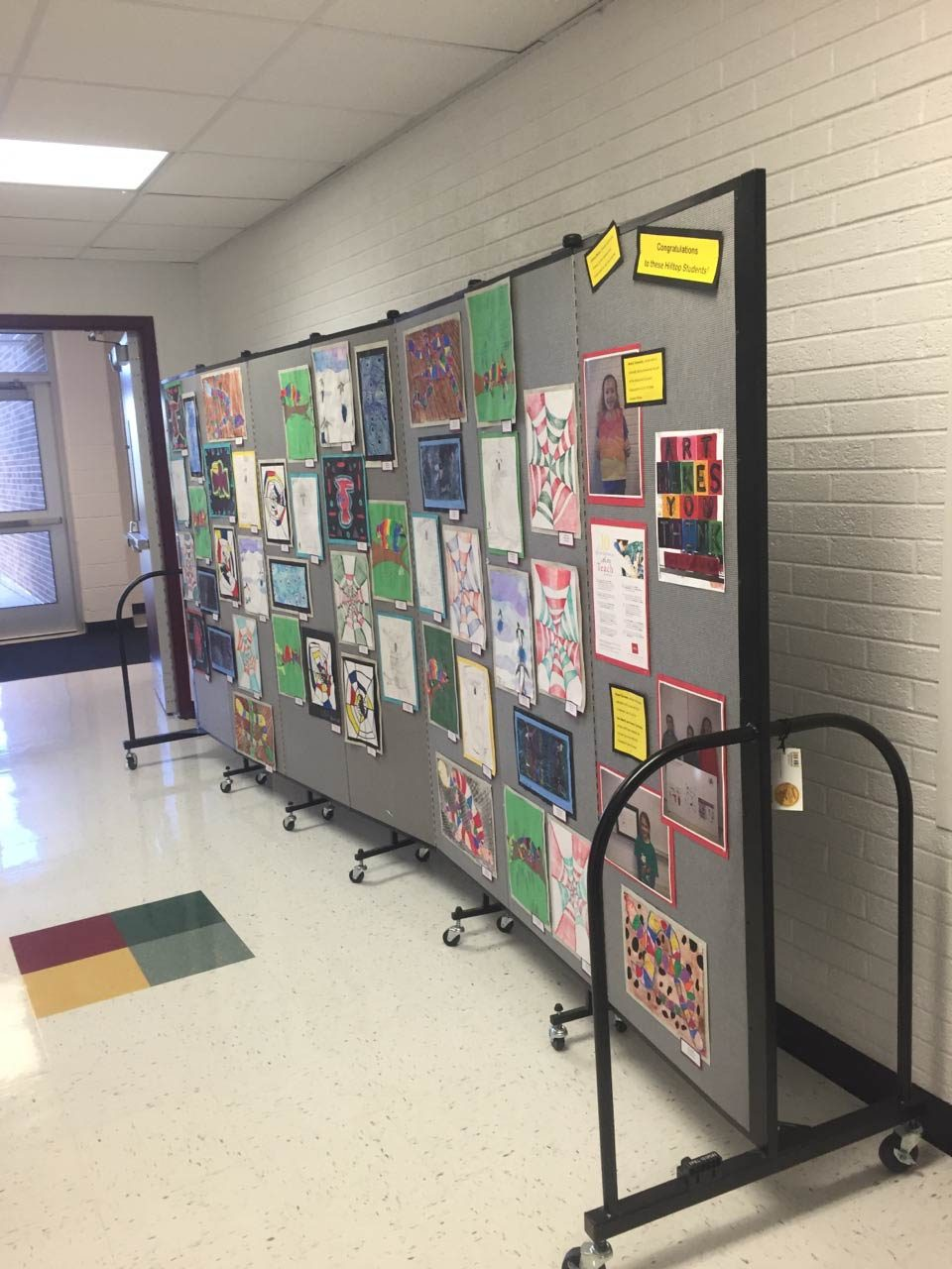 Tackable walls display artwork in a school hallway