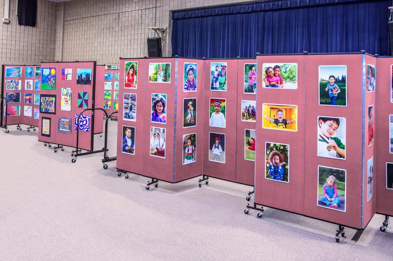 Create an artshow in a school gym with the help of tackable rolling dividers