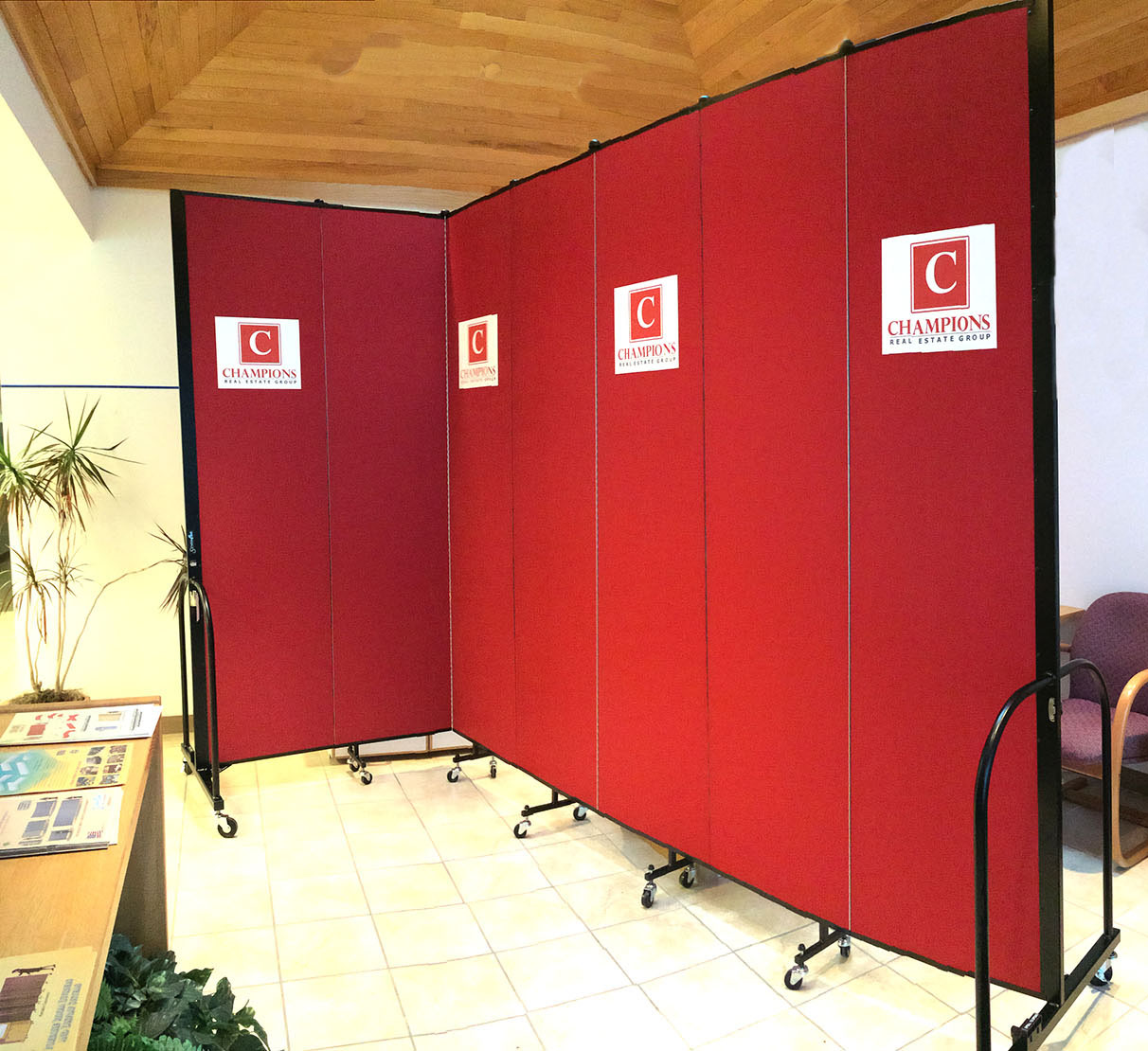 Red Room Divider with a logo pressed onto the fabric panels