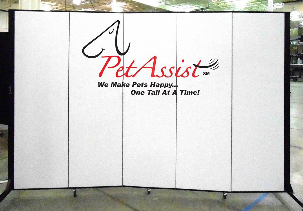 Pet Assist logo on a white portable room divider