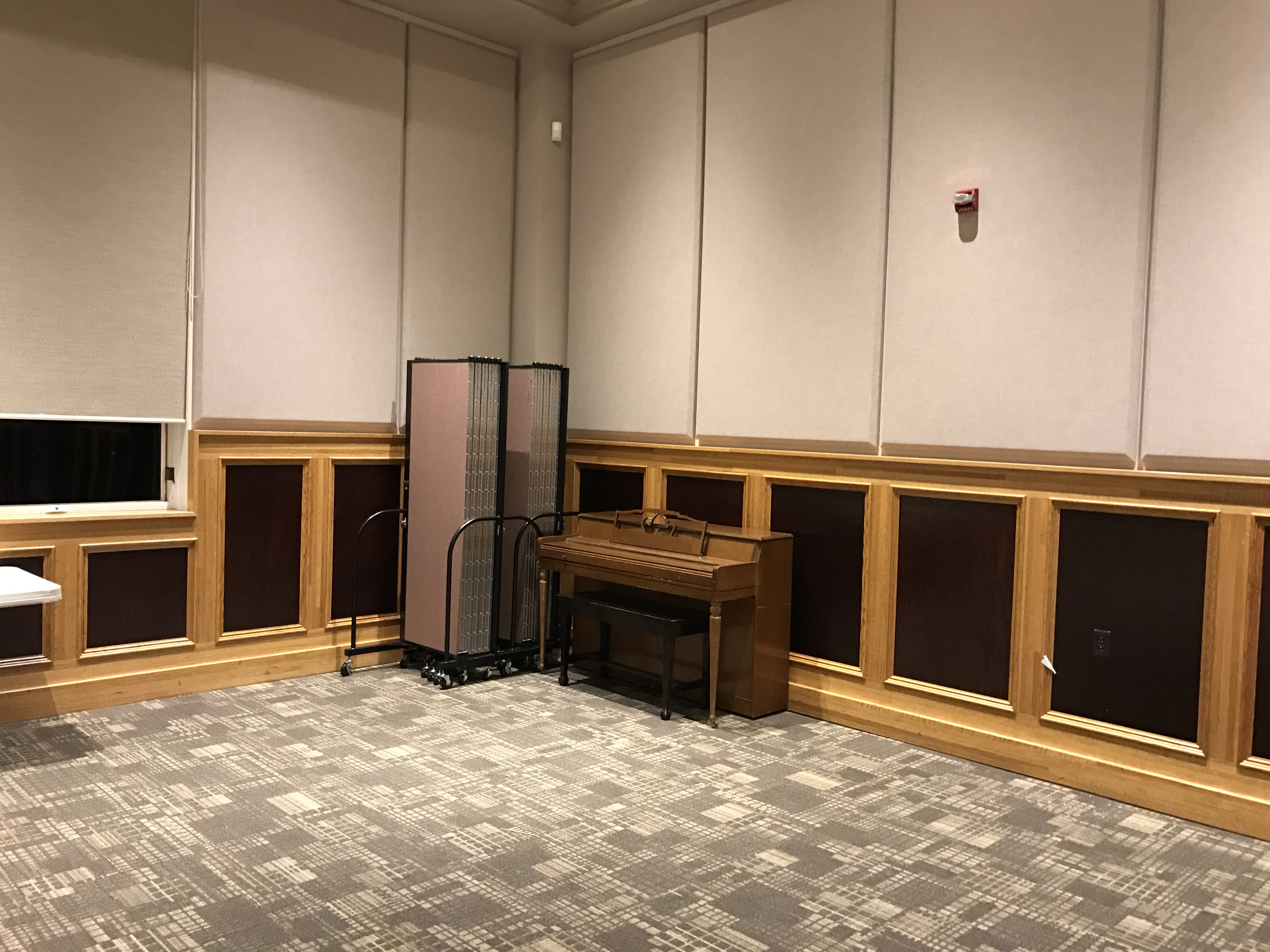 Church room divider stores compactly