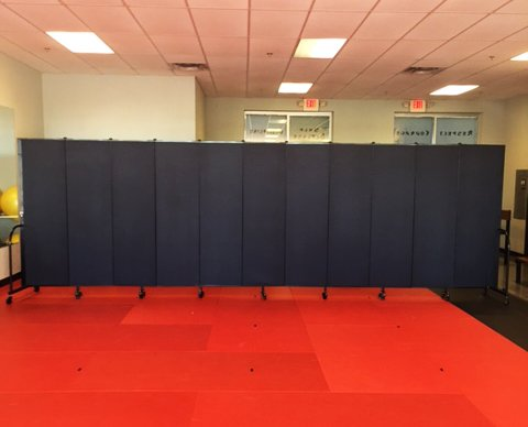 Divider provides privacy in a karate studio