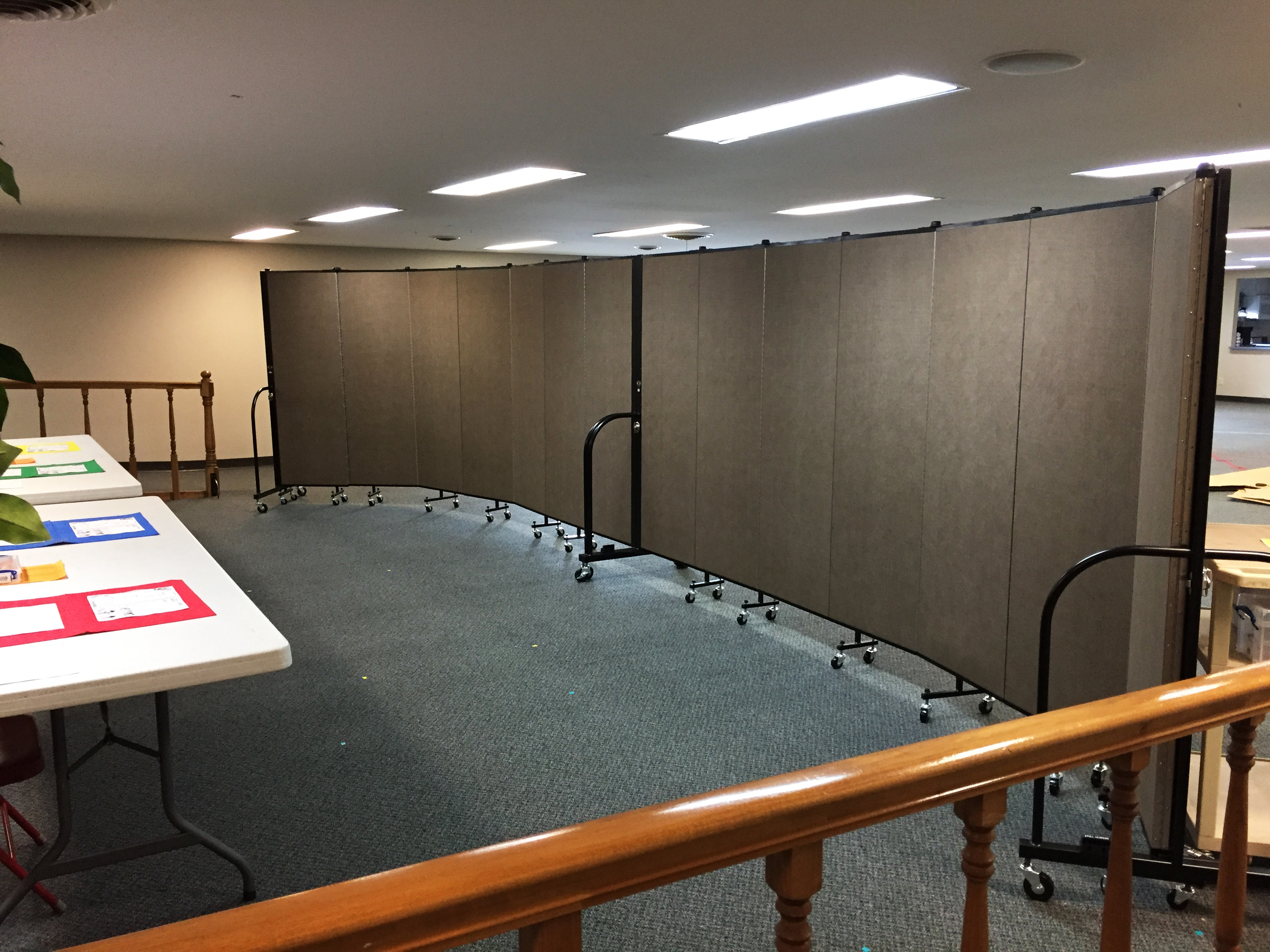 Two room dividers connected to divide a room in two