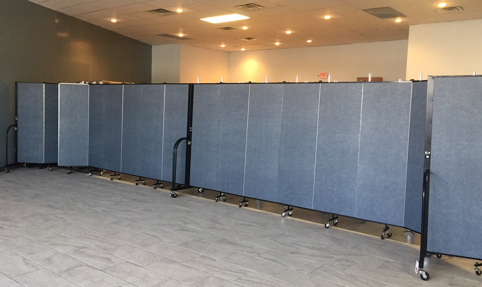 Sound absorbing temporary walls provide ample space for multiple classrooms within one room