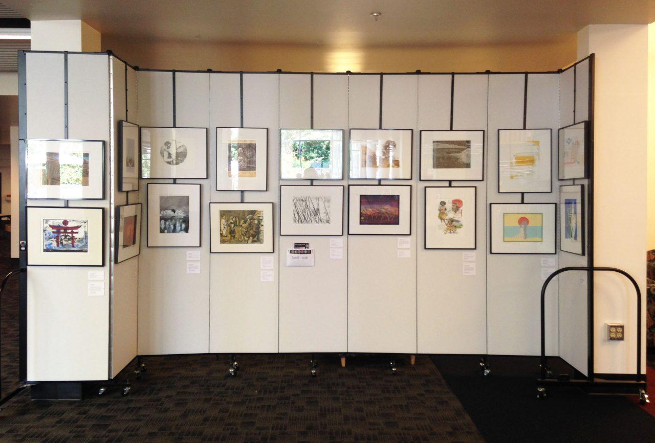 Artwork hangs on Screenflex art display panels