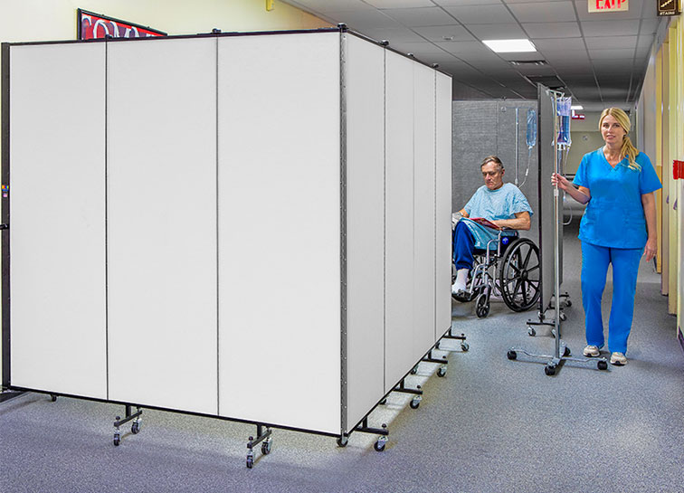 Two hospital privacy medical screens provide a private area for patients