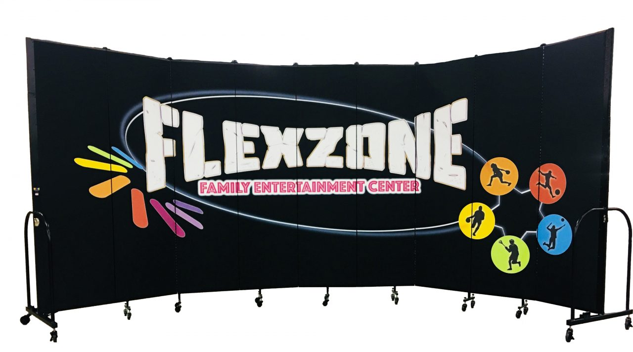 A mural titled Flexzone is printed on a black room divider