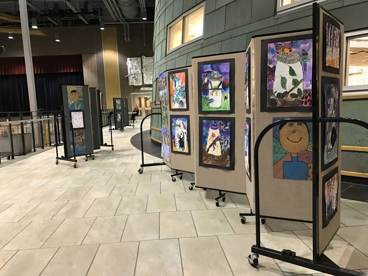 Artwork is displayed on portable partitions in a school