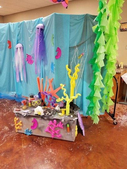 A sea theme VBS decorative backdrop is created on a rolling partition wall