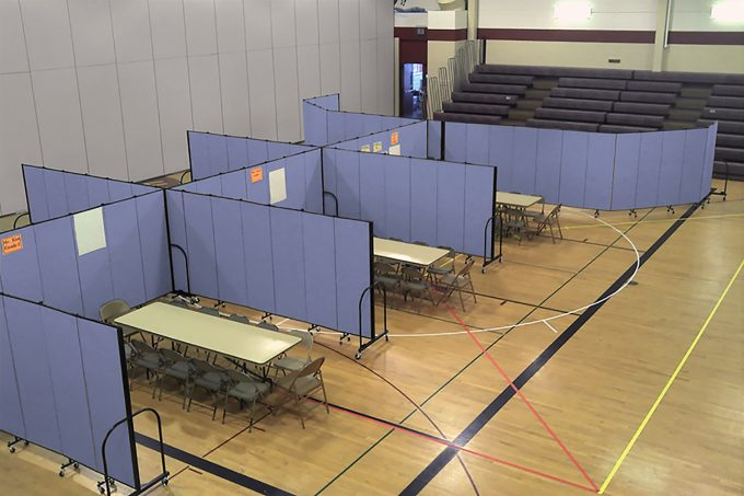 Movable partition walls create classrooms in a school gym