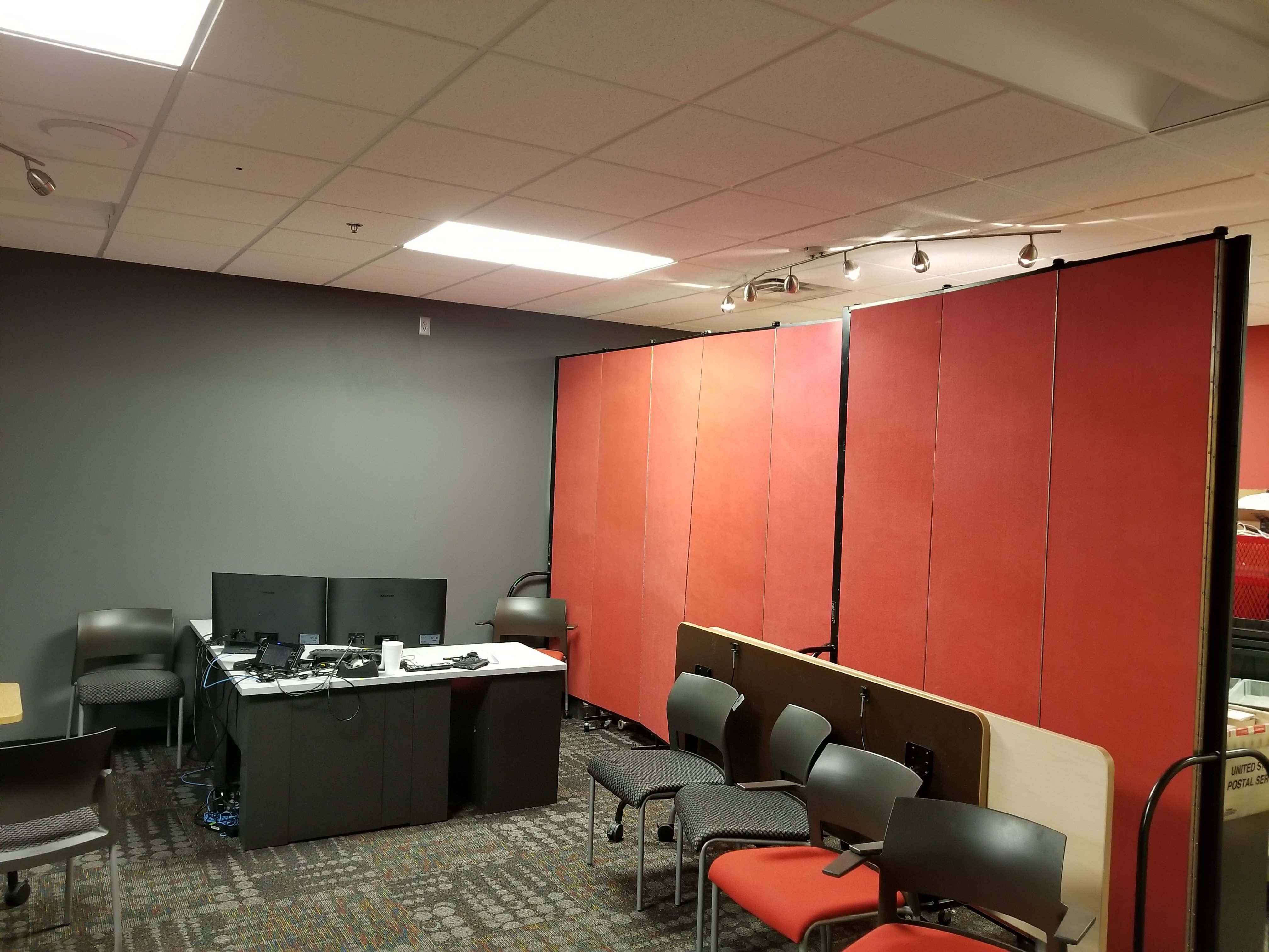 Rolling walls divide an office into two rooms to increase the use of space